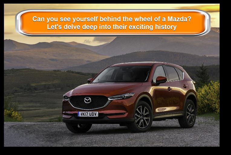 Mazda parked with mountaenous background