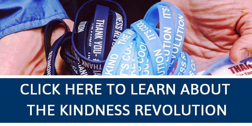 person holding kindness revolution bracelets