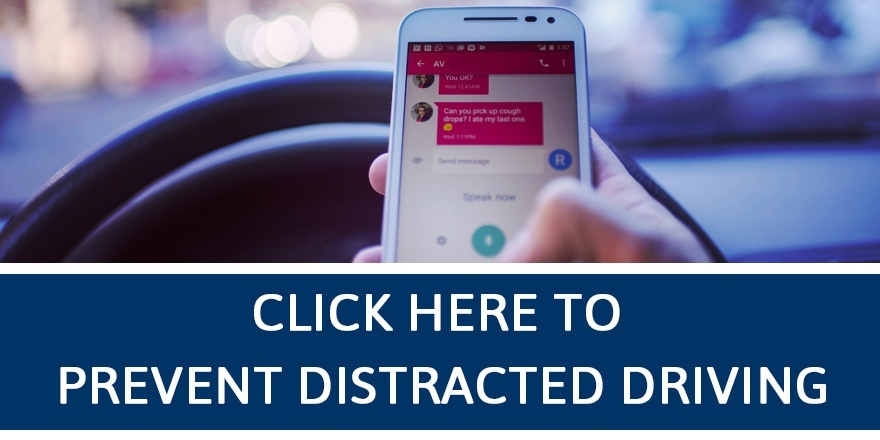 Person driving while using their cell phone.
