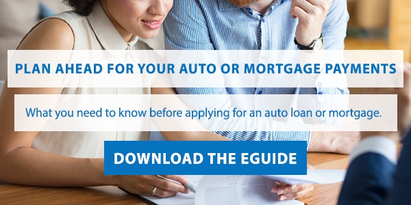 plan ahead for your auto or mortgage payments image with couple looking over paperwork