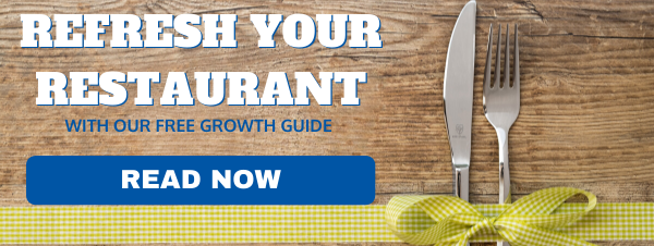 Table with silverware and button for free guide for Florida restaurants