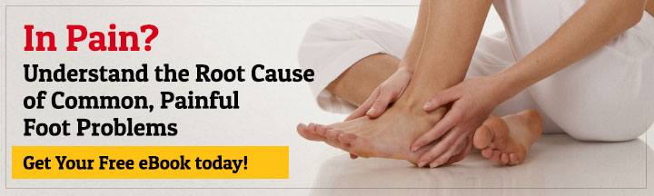 Holding foot in pain- root cause of painful foot problems