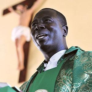 Father Fabian giving Mass