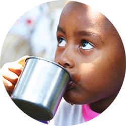 Child drinking a cup of cool, clean water